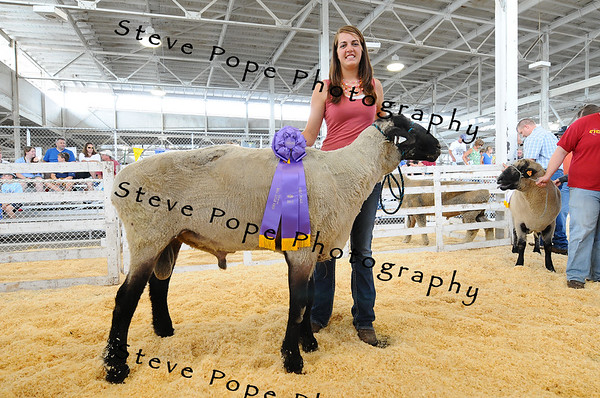 Kelly Foertsch, of Runwick, poses with her award winning 'Big Ram', weighing in at 405 pounds, at the Iowa State Fair on Aug. 8. (Iowa State Fair/ Steve Pope Photography)