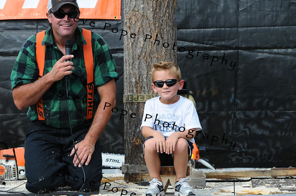 Colton Klovda, 6, of Altoona, participates in the Timberworks Lumberjack Show in the Kids' Zone at the Iowa State Fair on Aug. 9. (Iowa State Fair/ Steve Pope Photography)