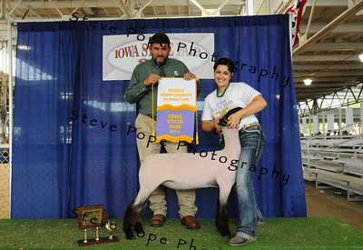 Chelsea Schminke, of Van Horne, poses with her Reserve Grand Champion FFA Market Lamb at the Iowa State Fair on Aug. 8. (Iowa State Fair/ Steve Pope Photography)