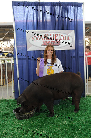 Brittany Barker, 17, of St. Ansgar, poses with her award winning derby hog at the Iowa State Fair on Aug. 9 (Iowa State Fair/ Steve Pope Photography)