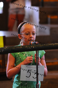 Allison Hildebrand, 9, of Brooklyn, participates in the Spelling Bee in Pioneer Hall at the Iowa State Fair on Aug. 9. (Iowa State Fair/ Steve Pope Photography)