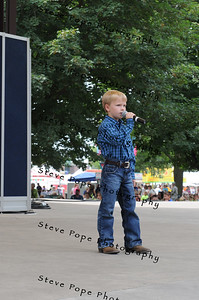 Heston McIlrath, 7, of Story City, performs a vocal solo in the Bill Riley Talent Search at the Iowa State Fair on Aug. 8. (Iowa State Fair/ Steve Pope Photography)