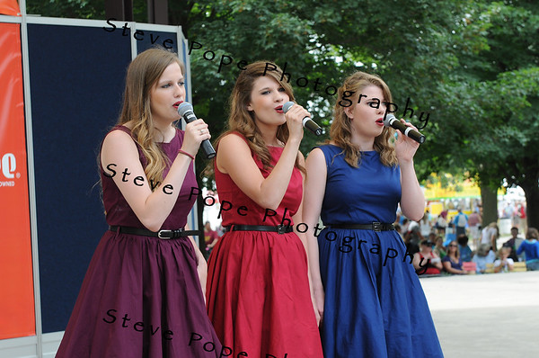 Samantha Lau, 21, Stephanie Lau, 19, and Shawnessy Lau, 17, of New Hampton, perform a vocal trio in the Bill Riley Talent Search at the Iowa State Fair on Aug. 8. (Iowa State Fair/ Steve Pope Photography)
