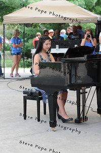 Shana Liu, 13, of Urbandale, performs a piano solo in the Bill Riley Talent Search at the Iowa State Fair on Aug. 8. Liu's performance qualified her for the semi-final round of the Bill Riley Talent Search. (Iowa State Fair/ Steve Pope Photography)
