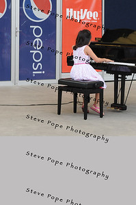 Maya Chu, 8, of Iowa City, performs a piano solo in the Bill Riley Talent Search at the Iowa State Fair on Aug. 8. (Iowa State Fair/ Steve Pope Photography)