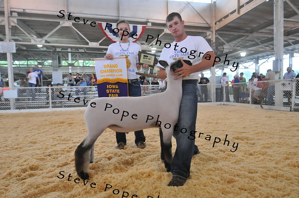 Tanner Berry, 21, of Lake View, shows his FFA Grand Champion Market Lamb while his sister Lexi Berry shows his ribbon and trophy at the Iowa State Fair on Aug. 7. (Iowa State Fair/ Steve Pope Photography)
