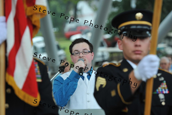 "Zachary Jones, 20, of Indianola, the winner of the Des Moines Register's ""Oh Say Can You Sing"" contest, performs the national anthem at the Opening Ceremony of the 2014 Iowa State Fair on Aug. 7. (Iowa State Fair/ Steve Pope Photography)"