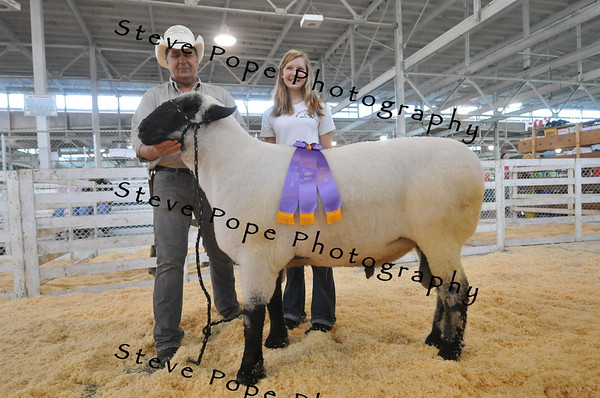 Eily Mickelson, 13, of Ames, proudly poses with her record weight holding Big Ram, Lover Boy, who weighed in at 501 pounds at the Iowa State Fair on Aug. 7. (Iowa State Fair/ Steve Pope Photography)