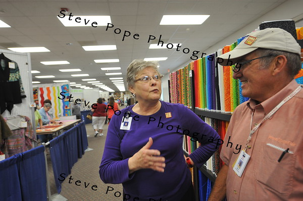 Colfax resident and Iowa State Fair Fabrics and Threads Division Superintendent Dorothy Faidley visits with Iowa State Fair Board Member Dave Hoffman, of LeMars, in the Varied Industries Building at the Iowa State Fair on Aug. 7. (Iowa State Fair/ Steve Pope Photography)