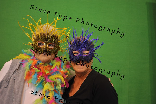 Laveta Aguiniga and Sandy Lambaren, of Indianola, play around in the photo booth located inside the Varied Industries Building at the Iowa State Fair on Aug. 7. (Iowa State Fair/ Steve Pope Photography)