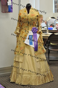 A dress made by Anne Hauser, of Des Moines, won the blue ribbon and best of show in the Fabric and Threads Department, on display in the Varied Industries Building at the Iowa State Fair on Aug. 7. (Iowa State Fair/ Steve Pope Photography)