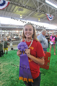 Lori Dvorak, 17, of Bondurant, proudly displays the Big Boar Grand Champion Ribbon she received at the 2014 Iowa State Fair on Aug. 7.  (Iowa State Fair/ Steve Pope Photography)