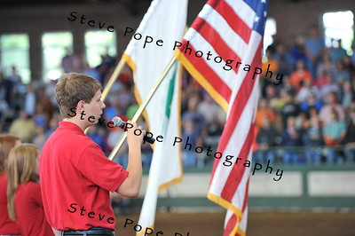 Tyler Steele, of Anita, sings the National Anthem in the 2015 4-H Breeding Beef Parade of Champions at the Iowa State Fair on Aug. 18. (Iowa State Fair/ Steve Pope Photography)