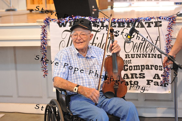 Phil McCrea, of St. Charles, after participating in the Fiddler's Contests at the Iowa State Fair on Aug. 16. (Iowa State Fair/ Steve Pope Photography)