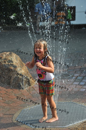 Four year old Hailey Johnson, of Webster City, plays in a fountain at the Iowa State Fair on Aug. 16. (Iowa State Fair/ Steve Pope Photography)