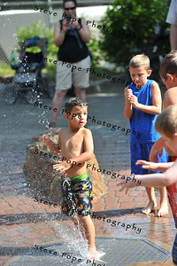AJ Hogate, 3, of Runnells, plays in a fountain at the Iowa State Fair on Aug. 16. (Iowa State Fair/ Steve Pope Photography)