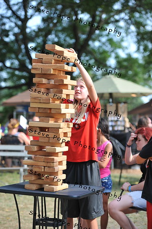 Thirteen year old Taylor McKinney, of Webster City, plays Jenga at the Iowa State Fair on Aug. 16. (Iowa State Fair/ Steve Pope Photography)