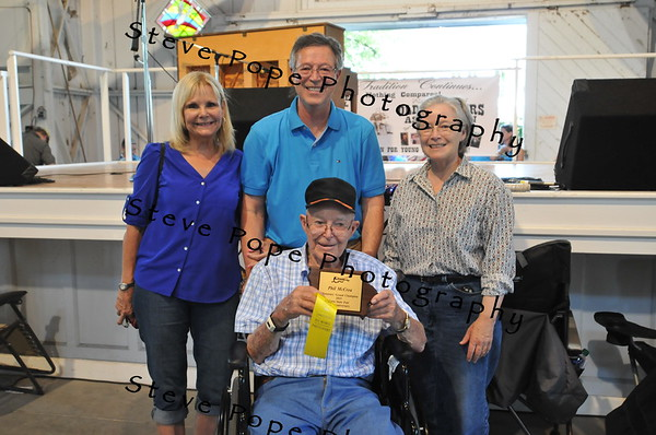 St. Charles resident Phil McCrea (front center) received a special Honorary Grand Champion Award for his years of participation in the Fiddler's Contest at the Iowa State Fair on Aug. 16. (Iowa State Fair/ Steve Pope Photography)
