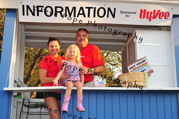 Kendra Parker, Frank Paul, and Kaedyn Parker, of Ankeny volunteer at an information booth at the Iowa State Fair on Aug. 16. (Iowa State Fair/ Steve Pope Photography)