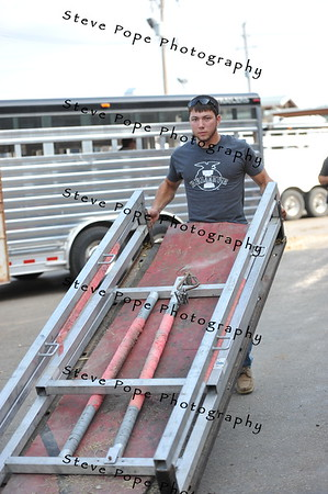 Trenton Cheers, of Indianola, moves a grooming chute at the Iowa State Fair on Aug. 16. (Iowa State Fair/ Steve Pope Photography)