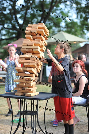 Eleven year old Ty McKinney, of Webster City, topples the Jenga stack at the Iowa State Fair on Aug. 16. (Iowa State Fair/ Steve Pope Photography)