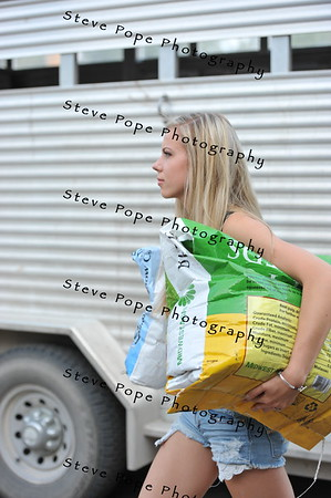 Katie Cheers, 18, of Indianola, carries feed at the Iowa State Fair on Aug. 16. (Iowa State Fair/ Steve Pope Photography)