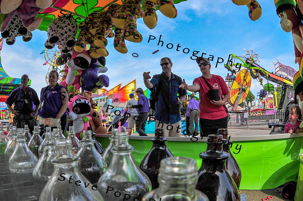 Nicolas Holzmueller, of Des Moines, plays the ring toss at the Iowa State Fair on Aug. 16. (Iowa State Fair/ Steve Pope Photography)