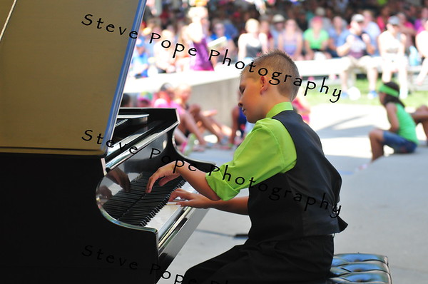 Ty Stephany, 10, of Altoona, performs a piano solo in the Bill Riley Talent Search at the Iowa State Fair on Aug. 14. (Iowa State Fair/ Steve Pope Photography)