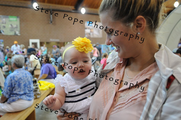 Six month old Hadley Dunn, of Central City, is held by former Iowa State Fair Queen Lacy Stevenson at the Iowa State Fair on Aug. 12. (Steve Pope Photography/ Iowa State Fair)