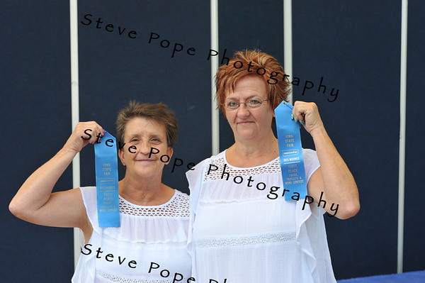 Patty Garland and Betty Judkins, of Des Moines, earned first place in the Least Alike category of the Twins, Triplets, and More Contest at the Iowa State Fair on Aug. 11. (Steve Pope Photography/ Iowa State Fair)