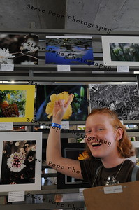 Emma Carlson, 17, of Des Moines, points at a photo she took on display at the Iowa State Fair on Aug. 12. (Steve Pope Photography/ Iowa State Fair)