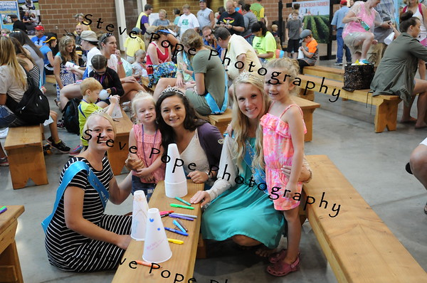 From left to right: Lyon County Fair Queen Grace Rens, 2 year old Makenna Dunn, of Central City, Woodbury County Queen Michelle Putze, West Pottawattamie Queen Alyssa Baatz, and 5 year old Tessa Brown, of Swisher, pose for the camera during the Breakfast with the County Fair Queens at the Iowa State Fair on Aug. 12. (Steve Pope Photography/ Iowa State Fair)