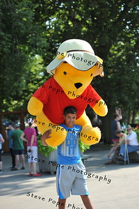 Jaedun Fyfe, of Martinsdale, carries a giant Winnie the Pooh that he won through the Iowa State Fair on Aug. 11. (Steve Pope Photography/ Iowa State Fair)