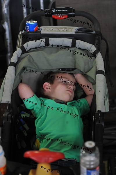Evan Greiman, 3, of Hudson, takes a nap in his stroller at the Iowa State Fair on Aug. 20. (Iowa State Fair/ Steve Pope Photography)