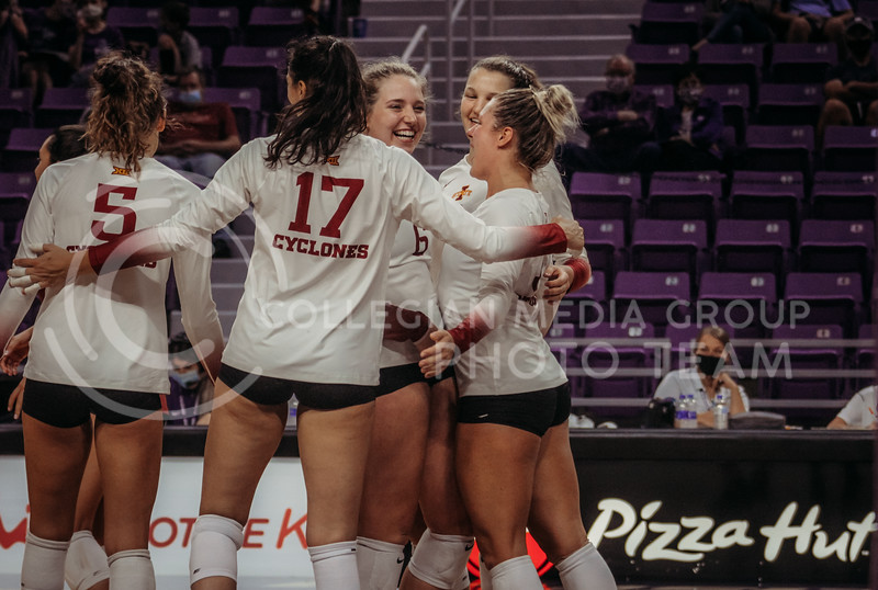 After winning an intense point, the team huddles together during the Kansas State volleyball game against Iowa State at Bramlage Coliseum on Sept. 26, 2020. (Sophie Osborn | Collegian Media Group)