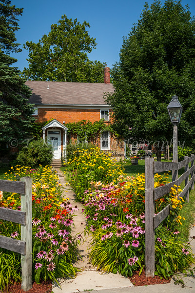 A front yard flower garden at a German home in the Amana Colonies, Iowa, USA.