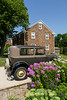 An antique car and a German home in the Amana Colonies, Iowa, USA.