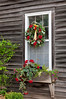 Decorative window wreath at a farmhouse in rural, Iowa, USA.