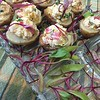 sassy peruvian chicken in potato cups with micro greens
