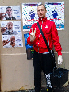 Paris, France,  French, LGBT Activism, AIDS Slogan, Militant Posing with PrEP Posters in the Marais Area,