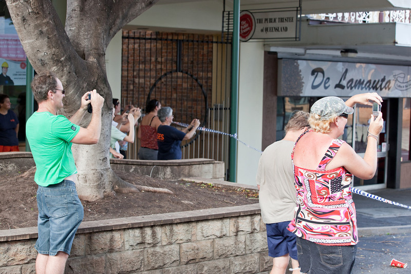 Spectators capture the moment as the flood peaks at intersection East St & Brisbane St Ipswich taken from Brisbane St - 12 Jan 2011