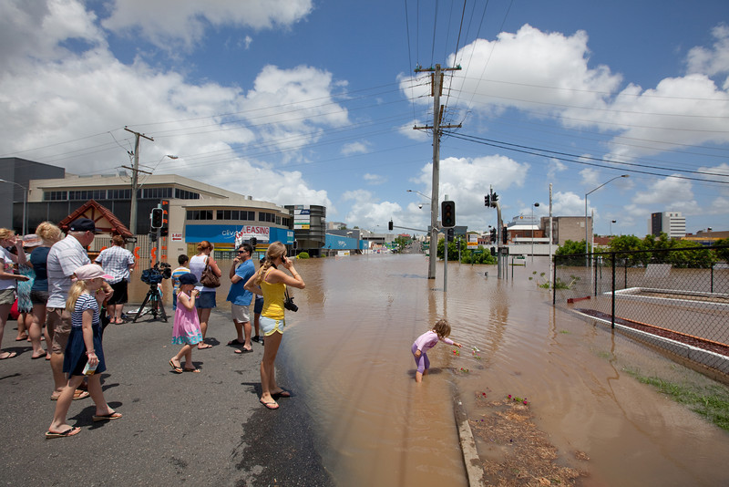 Spectators gathered at the intersection of Limestone St & Gordon St Ipswich as the flood waters rose to heights not seen since 1974 - 12 Jan 2011