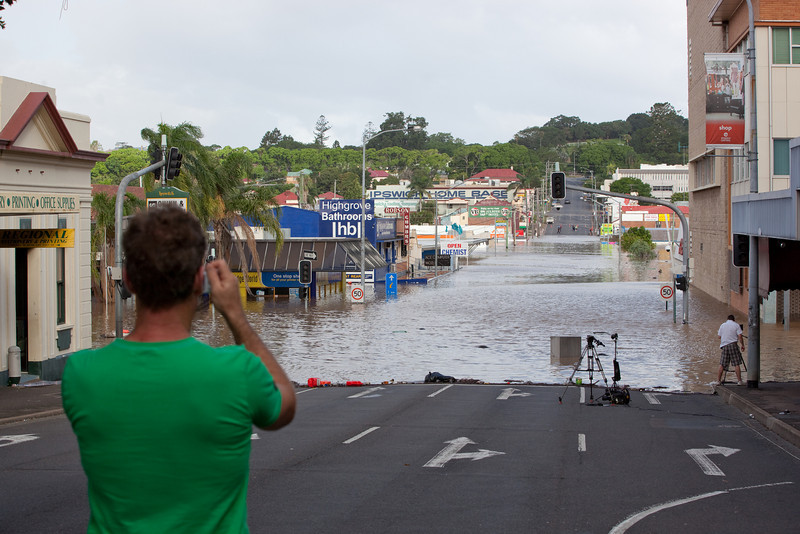 Spectators capture the moment as the flood peaks at intersection East St & Brisbane St Ipswich taken from Brisbane St looking towards Queens Park - 12 Jan 2011