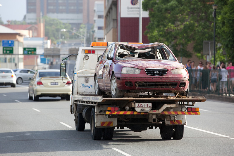 Vehicles were escorted by police vehicles from North Ipswich across the David Trumpy bridge through the Ipswich CBD - 12 Jan 2011