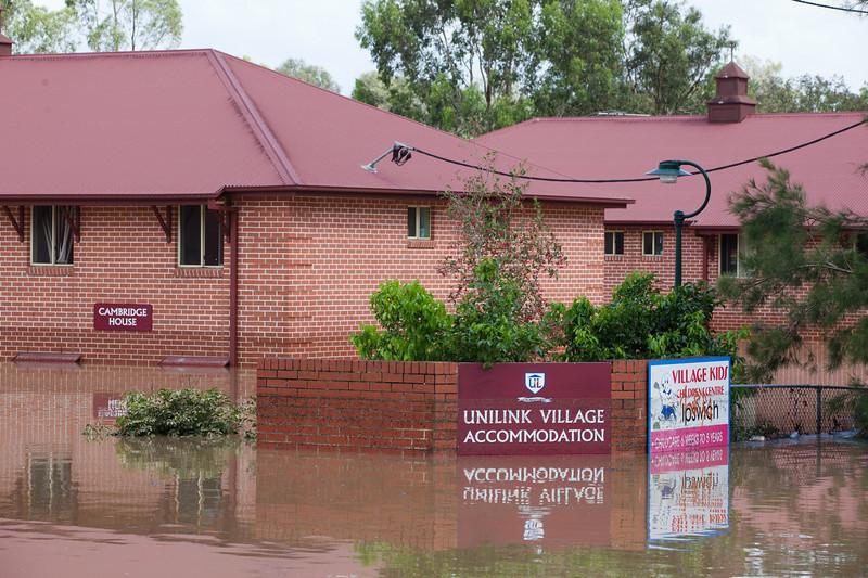 Warwick Rd Churchill - Unilink buildings surrounded by water after Deebing Creek broke its banks - 12 Jan 2011