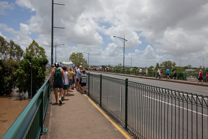 People flocked to the David Trumpy bridge to look at the flood waters not seen this high since 1974 - 12 Jan 2011