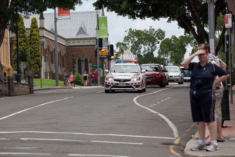 A police car travelling down Brisbane St towards Bell St escorting traffic through Ipswich City over the David Trumpy bridge to North Ipswich - 12 Jan 2011