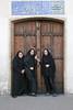 School girls at the door to Bagd-e-Fin (Fin Garden), Kashan, Iran