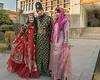 Traditionally-attired-visitors,-Zinat-ol-Molouk-House,-Shiraz,-Iran