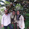 With Azim in his kiwi grove